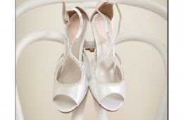 Brides shoes hanging on a chair