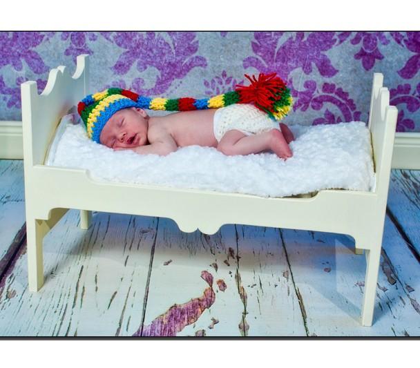 Newborn baby with woolen hat