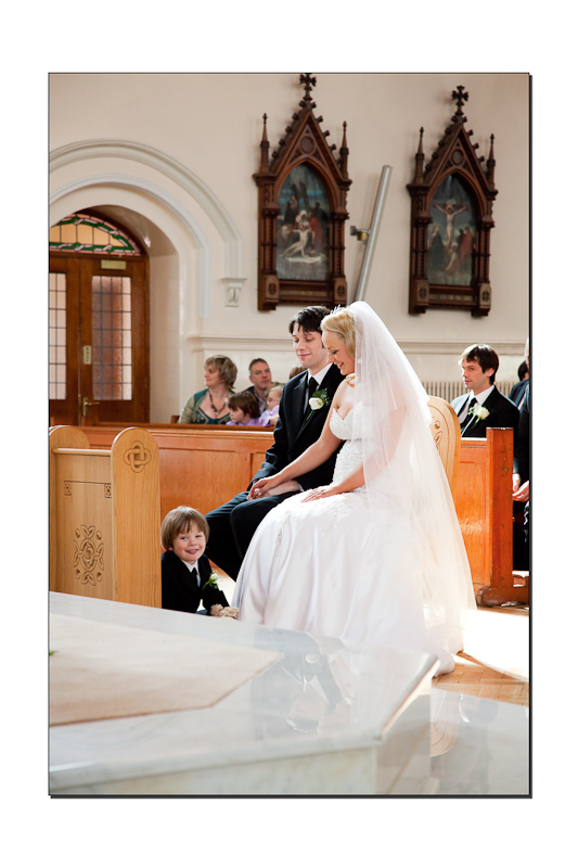 Bride and groom at the front of the church