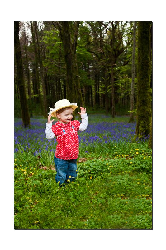 Little girl among the bluebells