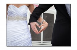 Bride & Groom make a loveheart with their hands