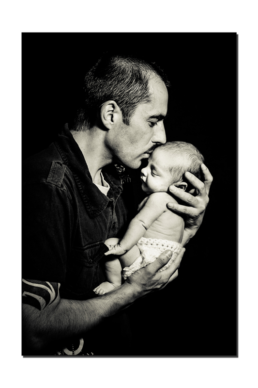 Loving Dad with his newborn son