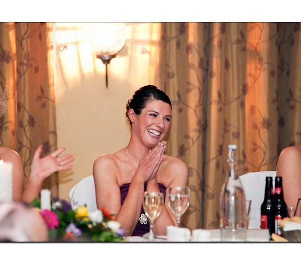Bridesmaid enjoying speeches