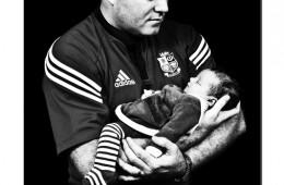 Father gazing at newborn