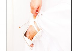 Bride putting on her shoe