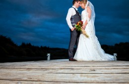 bride and groom at dusk on a wooden pier in castle caldwell belleek
