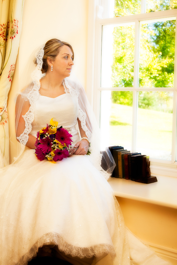 bride sitting in a large window in drumhallah house rathmullan co donegal