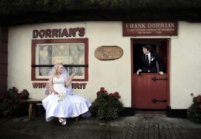 Donegal wedding photography bride and groom outside dorrians thatch pub ballyshannon