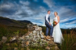 married couple on an old stone wall