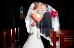 wedding photography donegal couple kiss in rathmullan church
