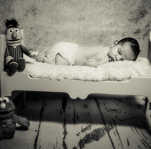 cute newborn baby sleeping with teddies