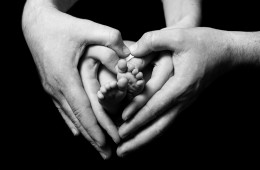 newborn babies feet in parents hands