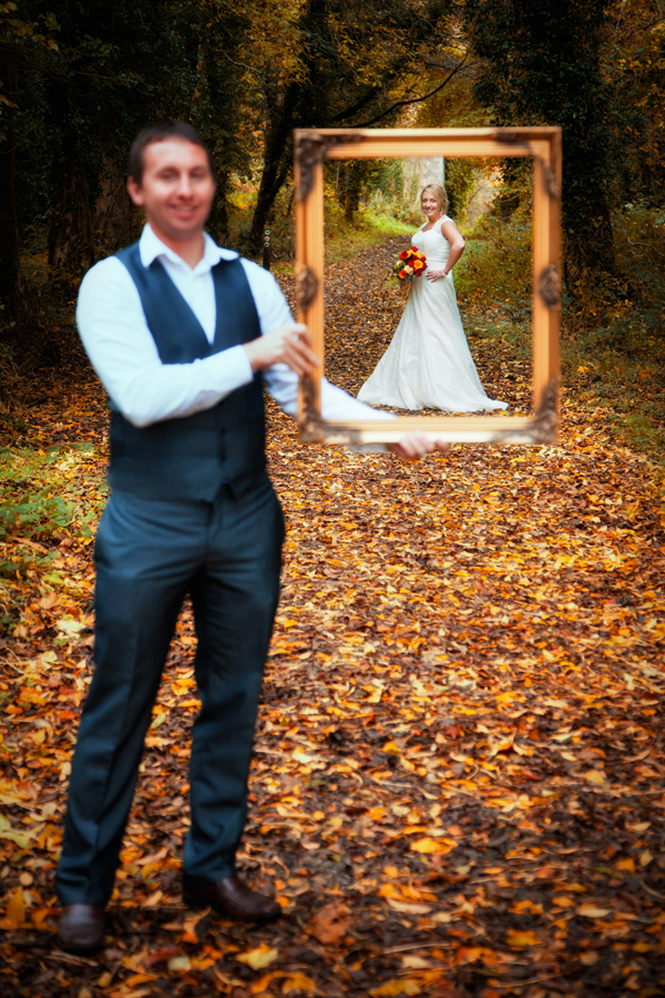 bridal portrait with the groom holding a frame