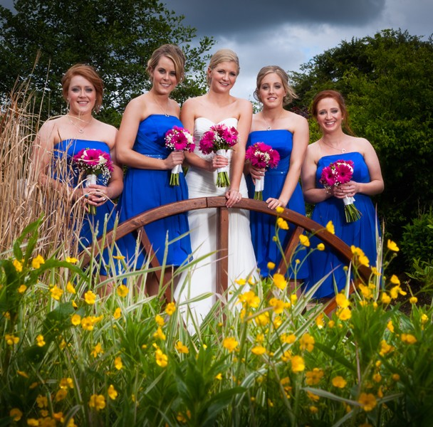 bride and bridesmaids in the garden of the mill park hotel