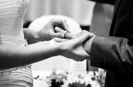 donegal wedding photography bride putting ring on grooms finger