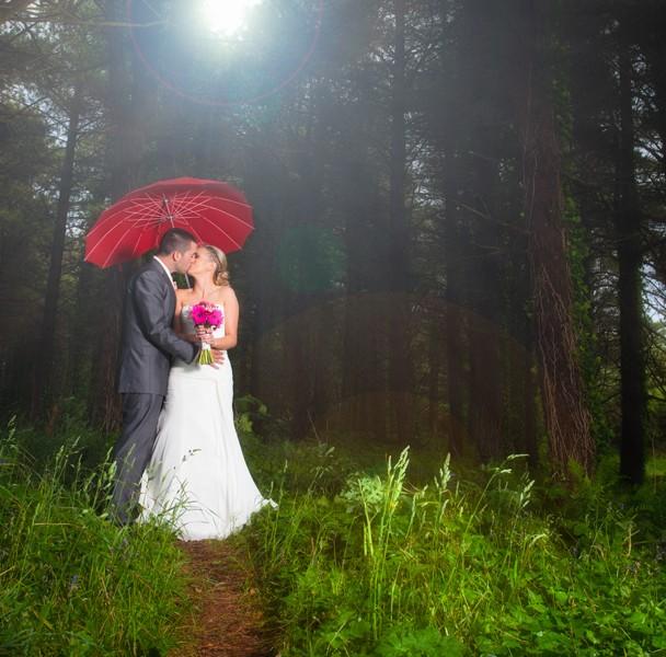 sligo wedding photographer couple in a forest with an umbrella