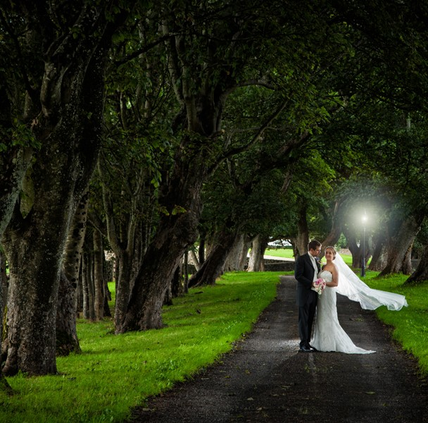 donegal wedding photography bride and groom in a tree lined lane