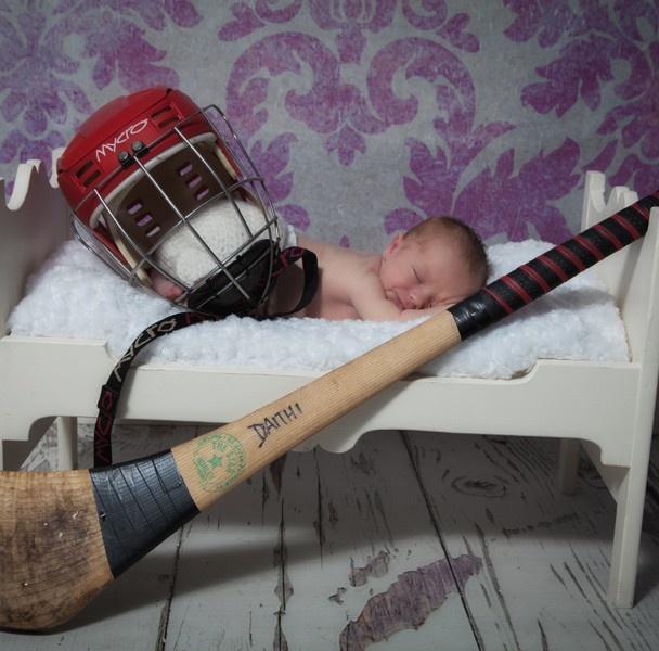 newborn baby photographer sligo baby boy with hurling gear