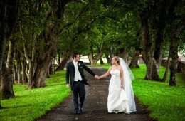 wedding photography donegal bride and groom hold hands walking