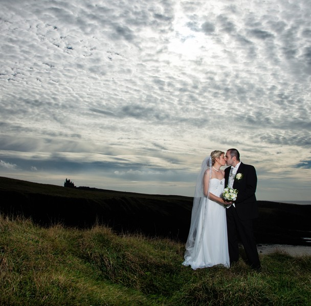 sligo wedding photographers couple in front of classiebawn castle in mullaghmore