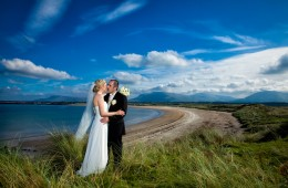 wedding photographers in sligo couple kiss at mullaghmore beach