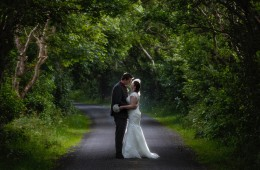 wedding photographers in donegal bride and groom on a tree lined country lane
