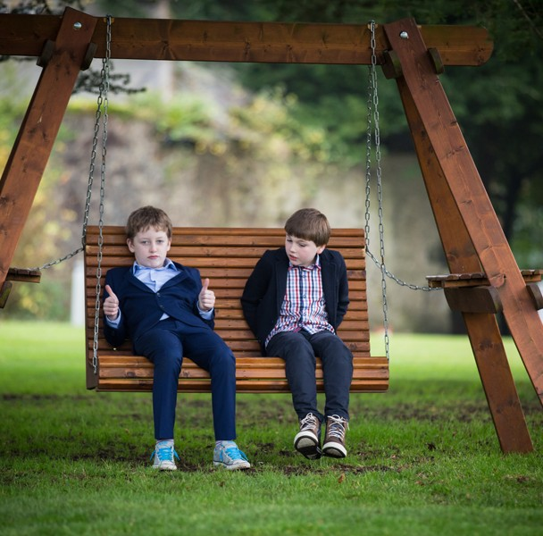 fermanagh wedding photo of guests sitting on as wooden swing
