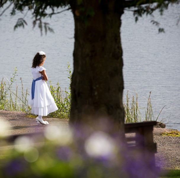 flower girl at harveys point hotel wedding looking out over lough eske