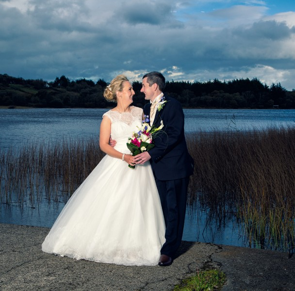 leitrim wedding photography bride and groom on the jetty at lough melvin