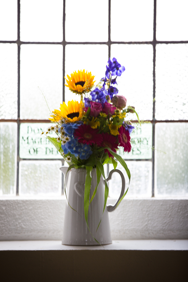 vase of flowers in the church window at sligo wedding