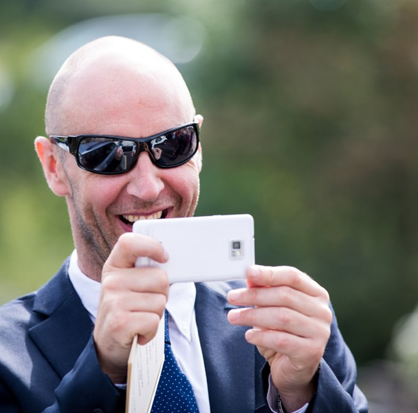 wedding guest taking a photo with his phone at a donegal wedding