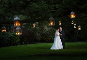 Donegal and Sligo Wedding Photographer bride and groom under a large tree at night with candle lanterns all around them