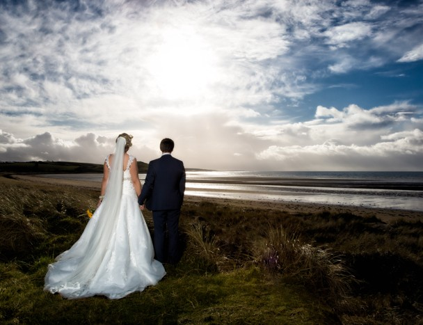 donegal wedding photography bride and groom look out across donegal bay