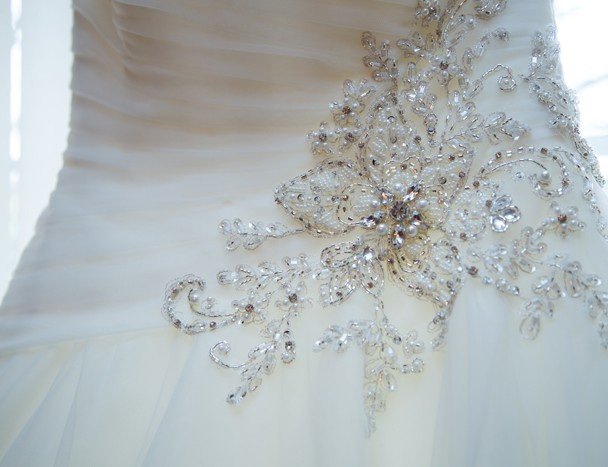 detail photo of the brides stunning wedding dress