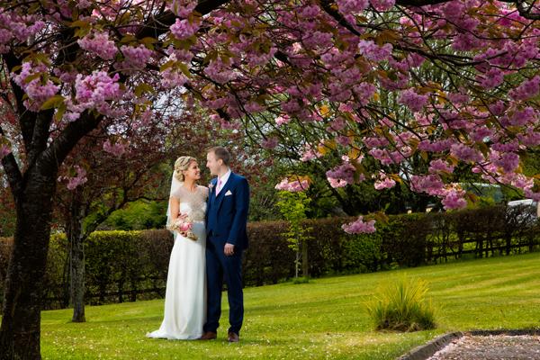 donegal and sligo wedding photographer bride and groom spring wedding with cherry blossom trees