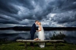 sligo wedding photographer bride and groom kiss beside old wooden bench