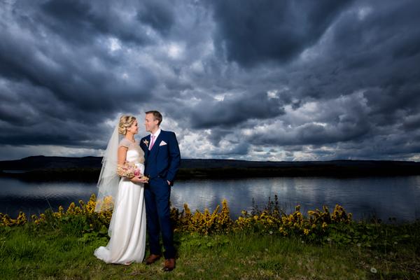 sligo wedding photographers bride and groom beside lough erne