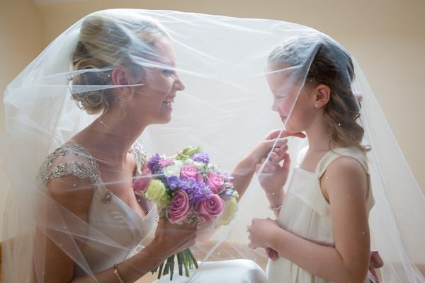 sligo wedding photography bride and flower girl under the viel