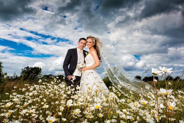 sligo wedding photography bride and groom in wild meadow