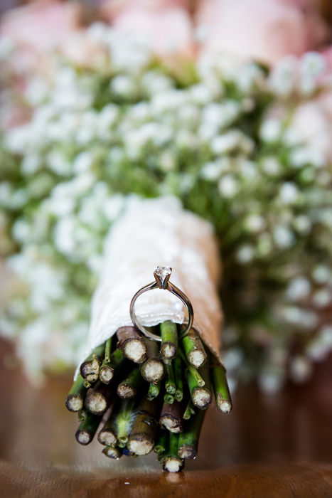 brides engagement ring in her wedding bouquet
