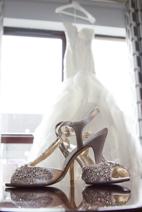 brides wedding shoes and wedding dress photo