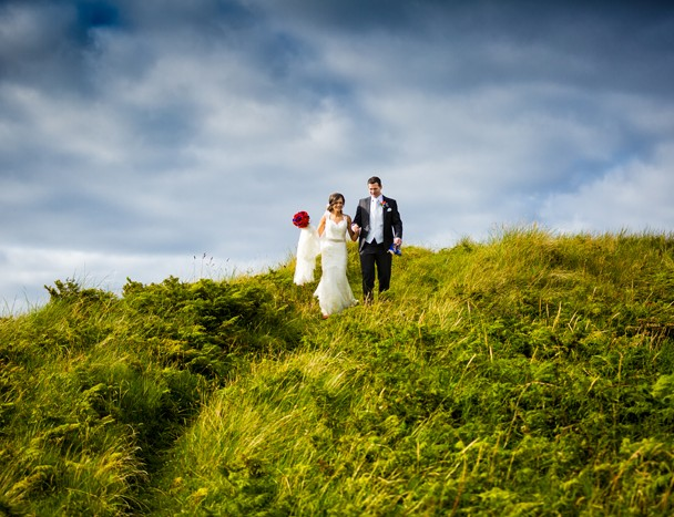 wedding photography in donegal bride and groom walk in the sand dunes