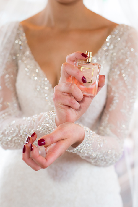 donegal wedding photography bride putting on her perfume