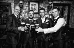 silver tassie hotel weddings groom and groomsmen enjoy a guinness