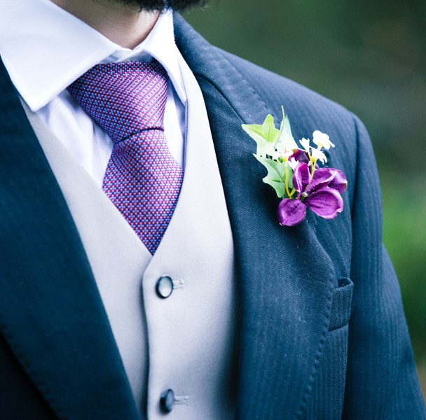 grooms purple tie and button hole