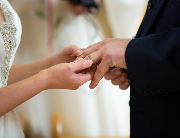 bride puts ring on her husbands finger