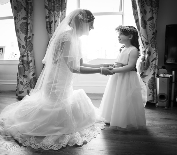 bride with her flower girl black and white photo