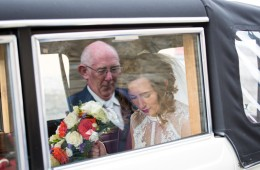 donegal wedding photographer bride in wedding car with her dad reflected in the window