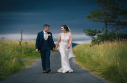 mill park hotel wedding bride and groom stroll along a country lane