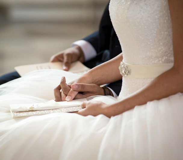 sligo wedding photographer bride and groom hold hands in the wedding ceremony